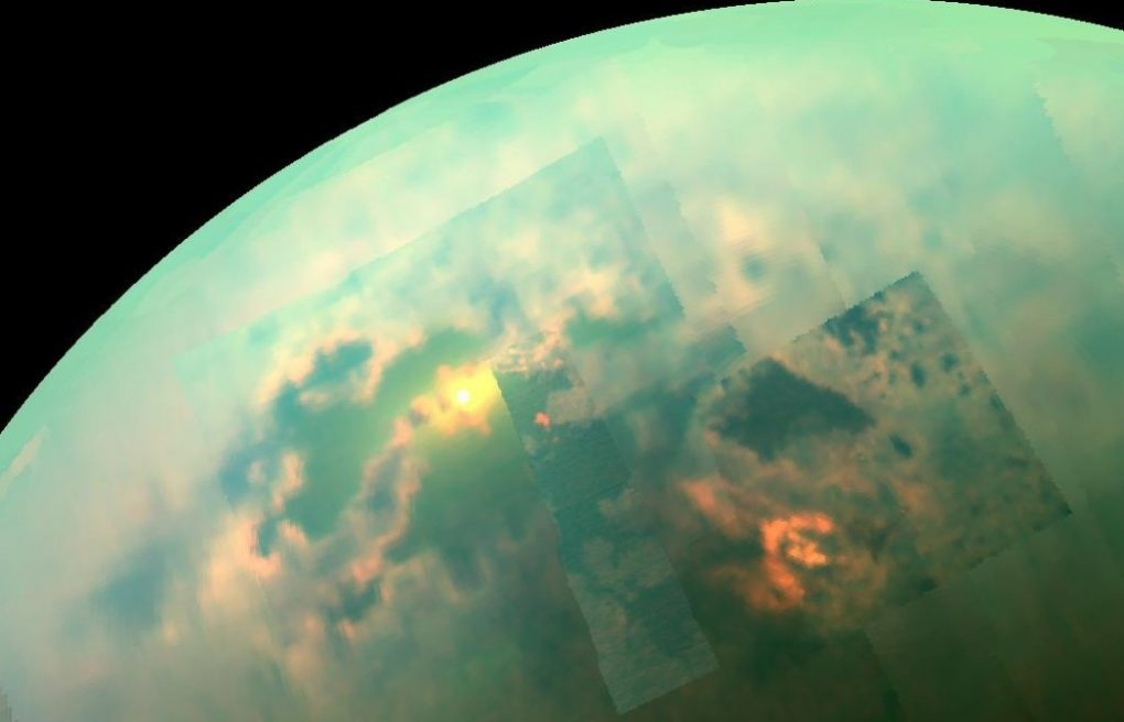 In this near-infrared mosaic, the sun shines off of the seas on Saturn's moon, Titan.